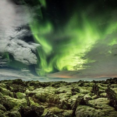 The lava in Iceland is both rough and tender with its soft moss. The aurora among the clouds in the sky shows the beauty of evenings in Iceland.
