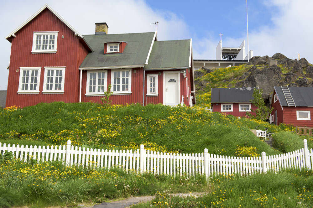 Red houses and church in Greenland.
