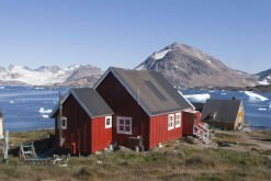 Icebergs and houses in Kulusuk, Greenland.